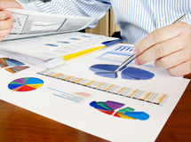 Analysing investment charts. Royalty Free Stock Image
