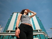 Analysing obstacles. Girl standing confident in front of a business building Analysing obstacles and future challenges Royalty Free Stock Photos