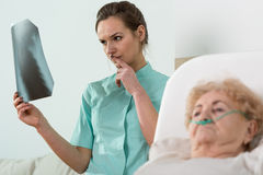 Analysing old woman's X-Ray Royalty Free Stock Photography