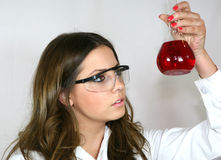Analysing the Red Solution. A student analyses a red solution stock photos
