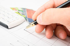 Analysis of business graphs royalty free stock photos