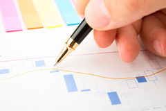 Analysis of business graphs stock photo