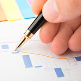 Analysis of business graphs stock image