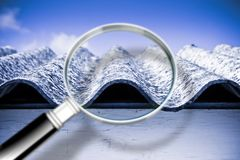 Analysis of the compounds of a dangerous asbestos roof - concept. Image royalty free stock photos