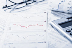 Analysis of the financial market. Rate tables and diagrams symbolize the volatility of the financial market Royalty Free Stock Photography