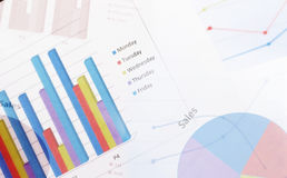 Analysis of financial reports. Paper financial graphs analysis on table Royalty Free Stock Photography