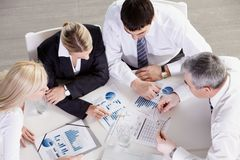Analysis of graphics. Above view of business team working with graphics