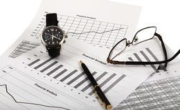 Analysis Of Market. Watch, pen and glasses lay on financial graph of parameters showing growth Stock Photography