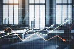 Analysis and market concept. Blurry office interior with forex chart arrows. Analysis and market concept. Double exposure Royalty Free Stock Images