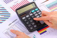 Analysis of sales plan, calculator on financial graph, business concept Stock Photography