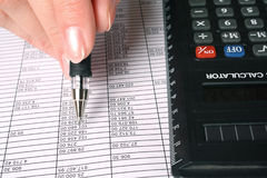 The analysis of statistical data. The analysis of financial data, the black calculator Stock Photography