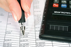 The analysis of statistical data. The analysis of financial data, the black calculator Stock Images