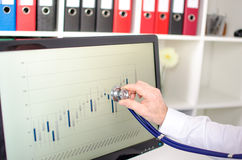 Analysis of stock market graphs with a stethoscope Stock Photos