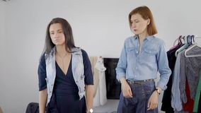 Analysis of the wardrobe. Women try on different outfits, and choose what to walk. A friend helps to choose the best