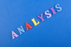 ANALYSIS word on blue background composed from colorful abc alphabet block wooden letters, copy space for ad text Stock Photos