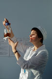 Analyst of chemical-biological enterprise Vita makes a test. St. Petersburg, Russia - December 6, 2016: Analyst of chemical-biological enterprise Vita makes a royalty free stock photos