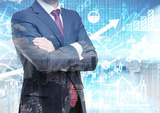 Analyst with crossed hands is standing in front of the digital financial calculations and predictions on the background. A concept. Of the capital market royalty free stock images