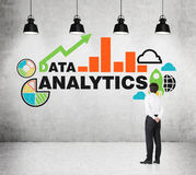 Analyst is standing in front of the drawn chart on the wall. Royalty Free Stock Photo