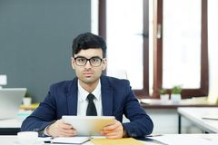 Analyst with touchpad. Confident employee with tablet analyzing online data in office stock images