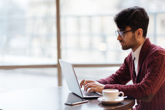 Analyst at work. Mobile businessman or freelancer networking in cafe royalty free stock image