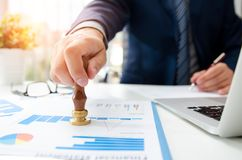 Analyst working approve stamp financial statement Stock Image