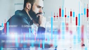 Analysts of crypro stock exchange sitting front of computer with technical price graph and indicator, red and green. Candlestick chart and stock trading stock photo