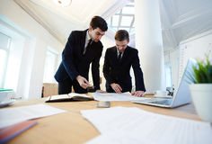 Analysts working. Businessmen negotiating and discussing financial data stock photo