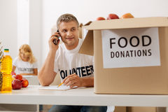Analytical confident volunteer discussing the shipment Royalty Free Stock Images