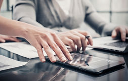 Analytical department working process.Closeup picture woman showing business reports modern tablet screen.Statistics Royalty Free Stock Images