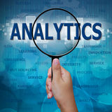 ANALYTICS in Magnifying glass Stock Images