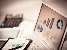 Analyz investment charts with laptop. Stock Image