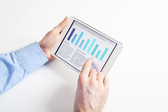 Analyzin financial data on tablet Royalty Free Stock Photos