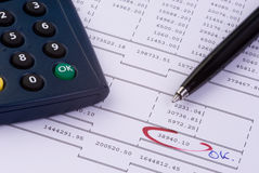 Analyzing the accounts. A calculator and a pen on a financial printout Stock Photo