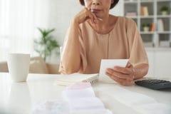 Analyzing bills Royalty Free Stock Photos