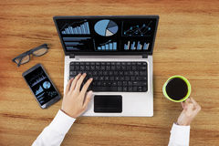Analyzing business chart on laptop Royalty Free Stock Photography