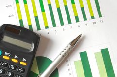 Analyzing a chart. Closeup of a business chart with pen and calculator Royalty Free Stock Images