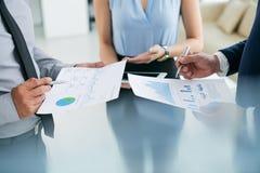 Analyzing charts Royalty Free Stock Photos