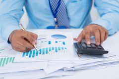 Analyzing charts and graphs Stock Photos