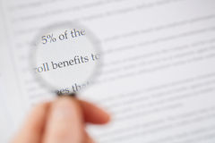 Analyzing Contract Benefits Royalty Free Stock Photos