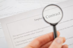 Analyzing Contract with Magnifying Glass Royalty Free Stock Image