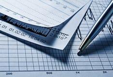 Analyzing diagram. Analyzing financial diagram with pen royalty free stock photo