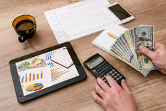 Analyzing and doing calculations, cup, mobile, pen Stock Image