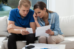 Analyzing family budget at home Stock Photos