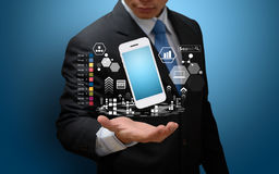 Analyzing financial charts with smart phone Royalty Free Stock Photo