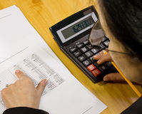 Analyzing financial data. Business concept with pen and calculator stock photography