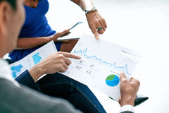 Analyzing financial report Royalty Free Stock Photo