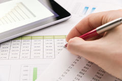 Analyzing financial report Stock Photo