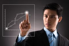 Analyzing futuristic diagram Stock Photography