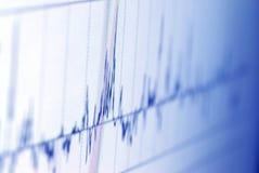 Analyzing graph on screen Stock Photo