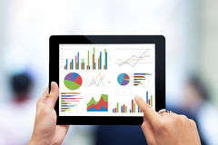 Analyzing graph with tablet Royalty Free Stock Image
